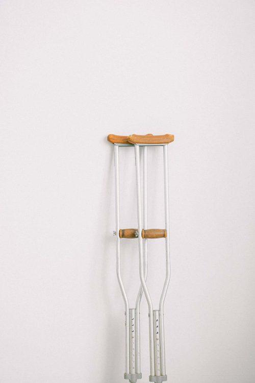 crutches-against-light-white-wall-3846157